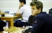 Rapid Day 3: Carlsen battles to title