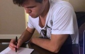 Carlsen signs to play Anand in Sochi