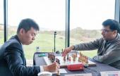 Grand Swiss 10: Caruana and Wang Hao lead
