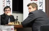 Caruana takes first round by storm