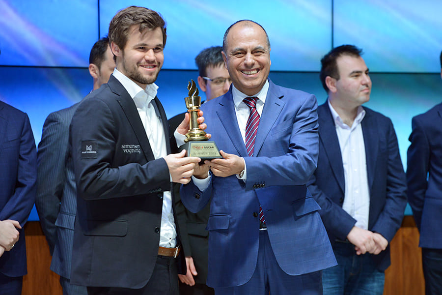 3a5f0301cf61 World Champion Magnus Carlsen receives his 4th Shamkir Chess trophy from  organiser and FIDE Vice President Mahir Mammadov